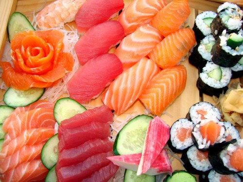 An assortment of seafood include sushi and sashimi.