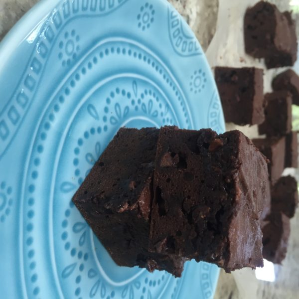 Lentil Walnut Brownies on a round blue plate. Ingredients include canned lentils, cocoa, eggs, flour, chocolate chips, walnuts.