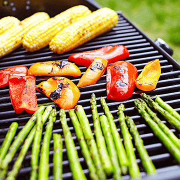 Asparagus, bell peppers, and corn on the BBQ.