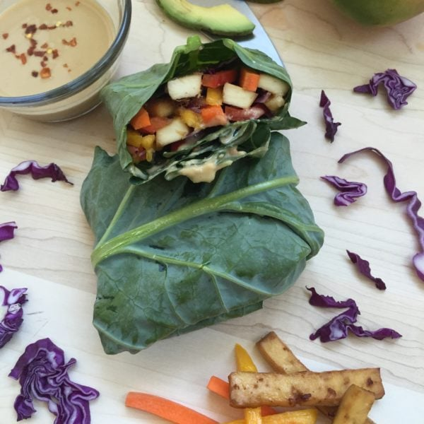 Tofu Stuffed Collard Greens. Ingredients include collard greens, tofu, ginger, garlic, purple cabbage, carrot, bell pepper, mango, avocado, mint.