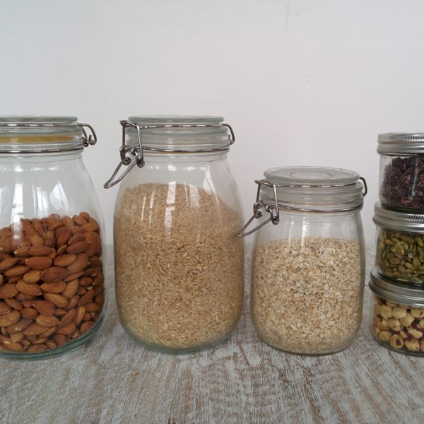 A photo of pantry items in storage jars.
