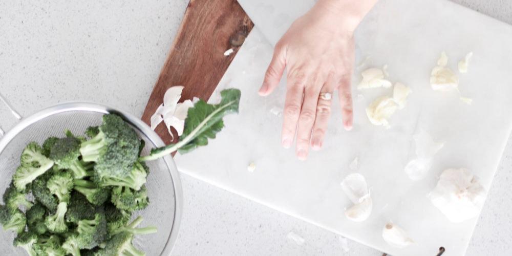 Lindsay Pleskot preparing food in the kitchen. Time Saving Kitchen Tools blog post.