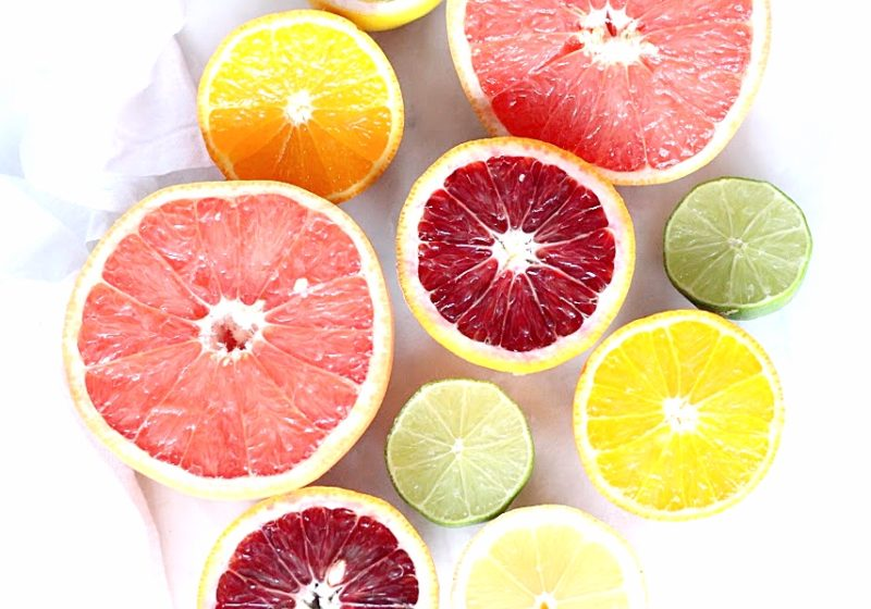A photo of different citrus fruits. Grapefruit, lemon, lime, orange.