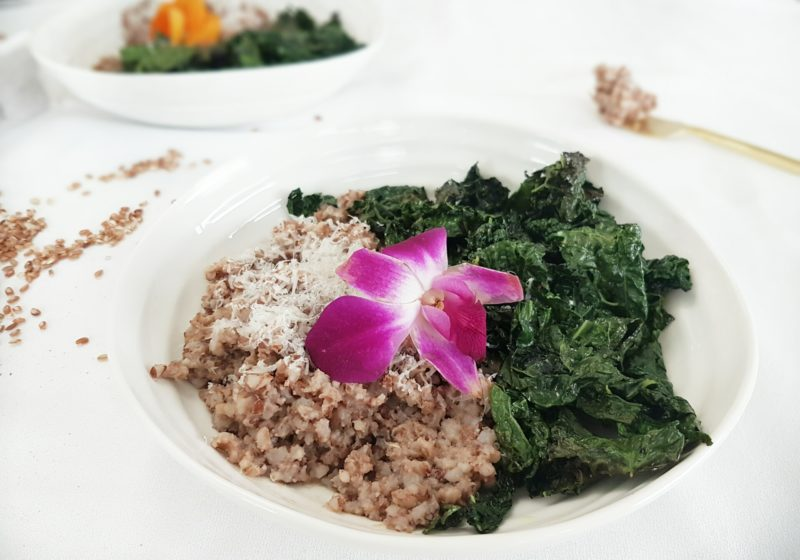 Easy Baked Brown Rice Lemongrass Risotto with Roasted Kale in a white round bowl. Ingredients include risotto, kale, shallot, garlic, short grain rice, lemongrass tea, Parmesan cheese.