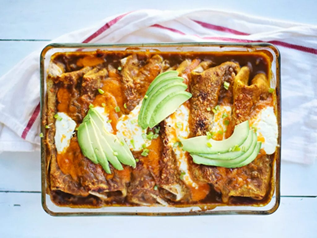 Image of Spicy Pumpkin Black Bean Enchiladas by Foodess, a recipe in the Healthy Pumpkin Recipes Roundup