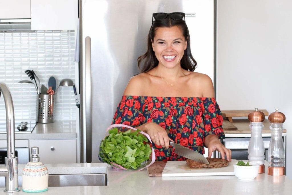 Lindsay Pleskot Registered Dietitian cutting skirt steak