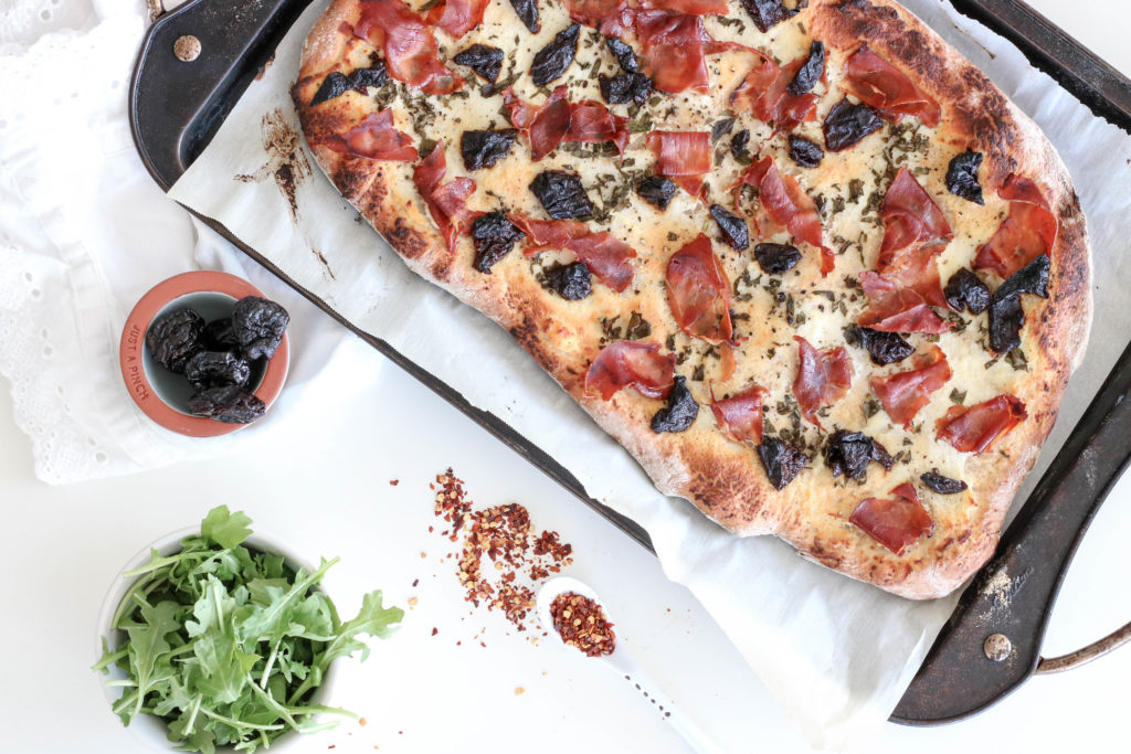 Rustic Prune Ricotta and Prosciutto Pizza Fresh Out of the Oven
