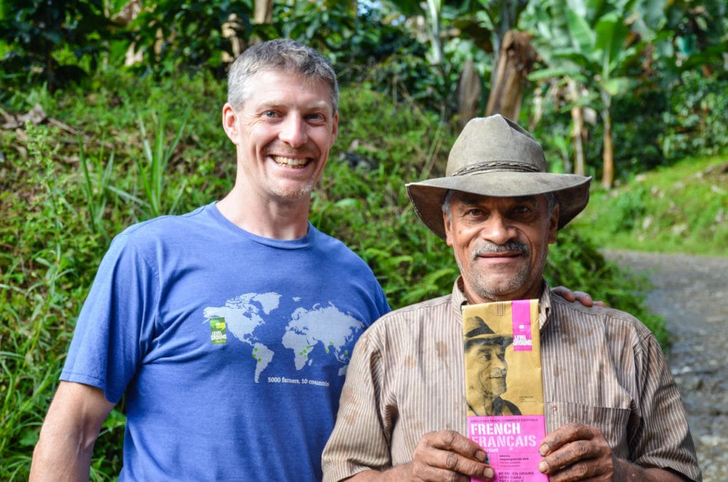 Luis Horacio holding the Level Ground Trading packaging from his farm for the first time
