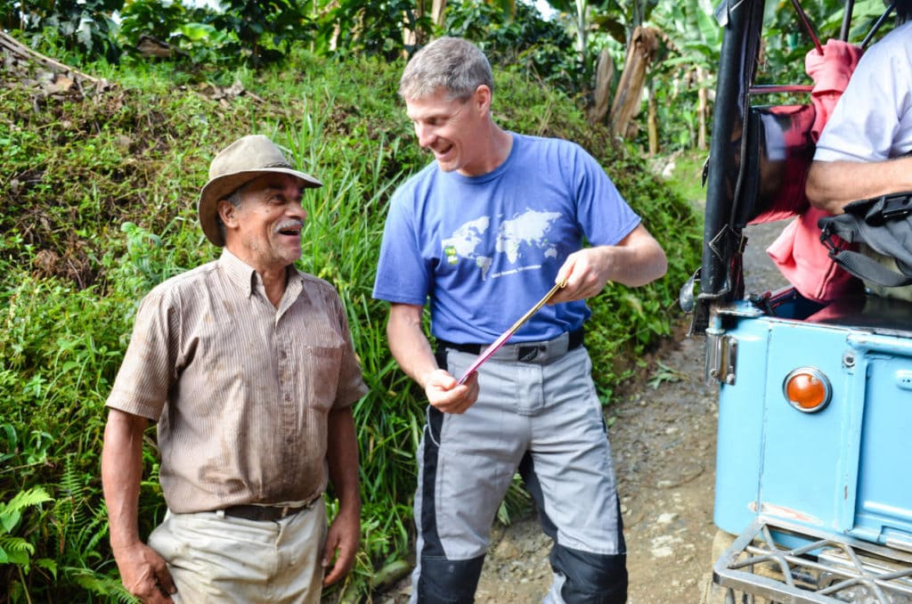 Luis Horacio, Farmer, sees his face on Level Ground Trading Coffee packaging for the first time