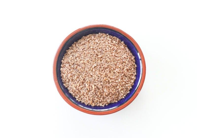 Bulgar in a blue bowl with a brown trim.