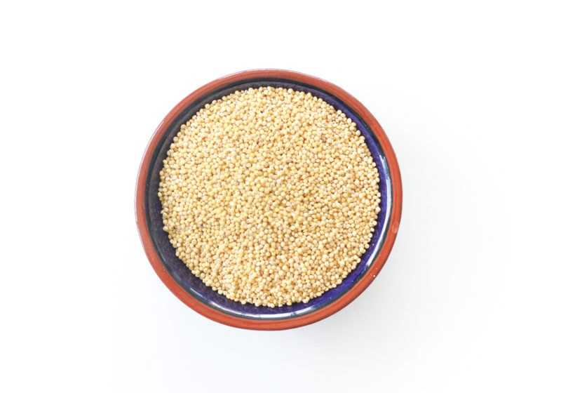 Millet in a blue bowl with a brown trim.