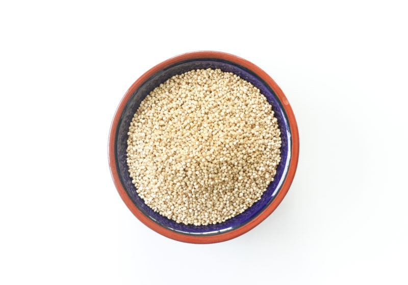 Quinoa in a blue bowl with a brown trim.