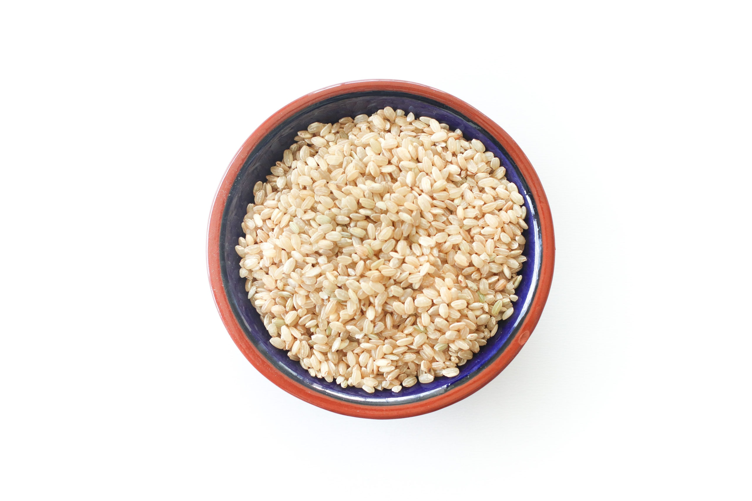 Rice in a blue bowl with a brown trim.
